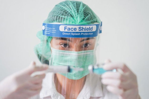Doctor in face shield and face mask